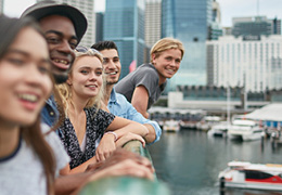 Young adults at a downtown city marina overlook